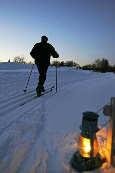 Cross country skiing on a trail lit by lanterns is offered on Tuesday and Thursday nights at Great Brook Farm in Carlisle.